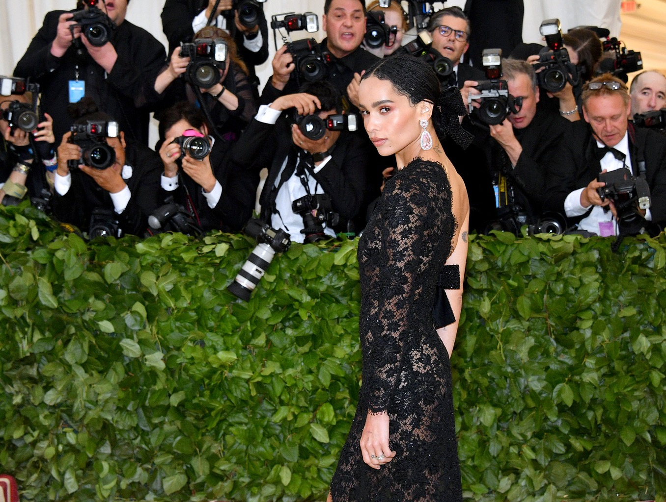 Zoë Kravitz on the red carpet at the 2018 MET Gala in May wearing her engagement ring as well as earrings form Jacob & Co. and a Yves Saint Laurent gown. Photo Getty