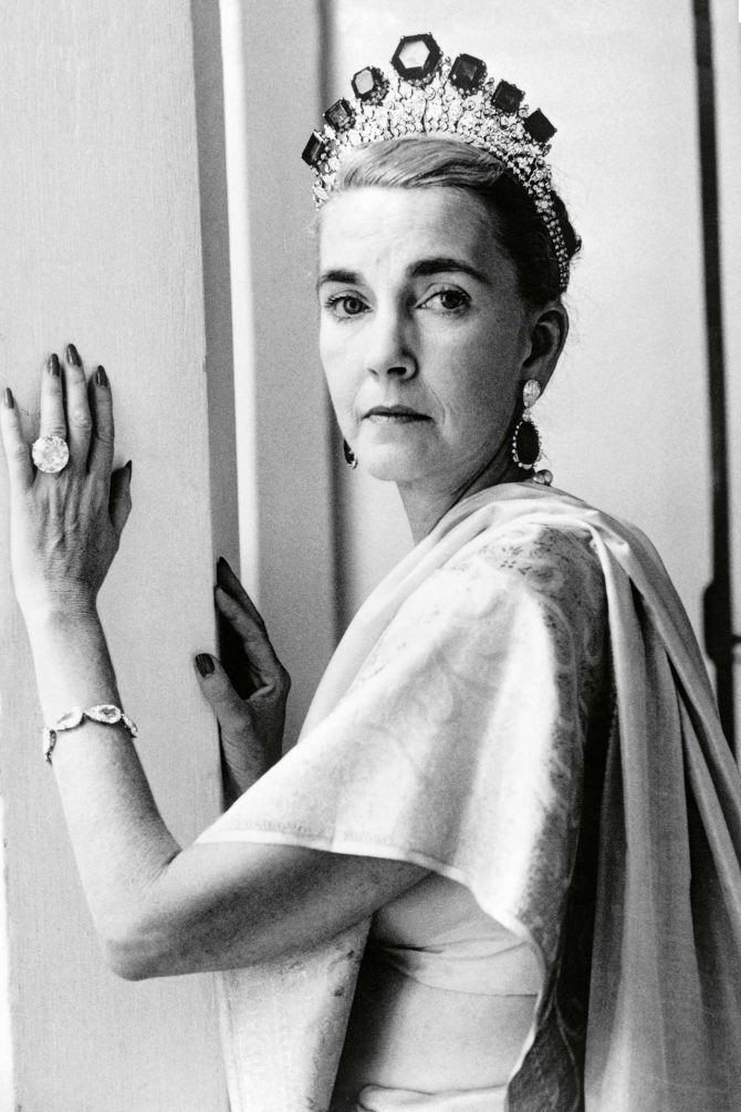 Barbara Hutton wearing her Cartier tiara set with emeralds from the Romanovs and her 40-carat Pasha Diamond ring.