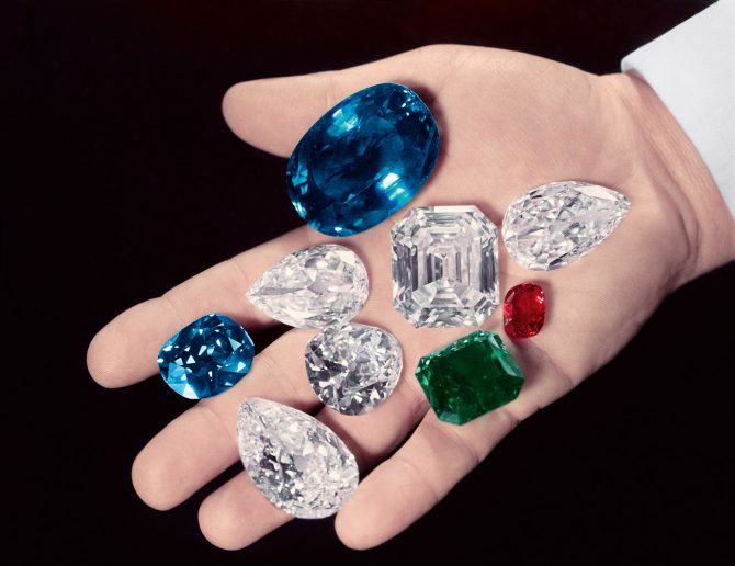 Mr. Harry Winston holding some of his famous gems for a 1952 article in Life magazine. The gems in his hand include, the Sapphire of Catherine the Great (next to thumb), the Hope Diamond (between index & middle), the Royal Spanish Emerald (green), the Idol's Eye (left of emerald), the Jonker Diamond (C, square cut), the Star of the East diamond (tear shaped, bottom), a large ruby and a pair of 50-carat matched pear shaped diamonds. Photo Bernard Hoffman/The LIFE Picture Collection/Getty Images