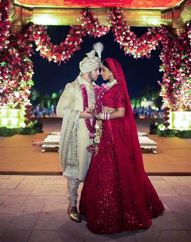 For the second ceremony, a traditional Hindu style event, Priyanka wore a custom red gown and necklace from Indian designer Sabyasachi.