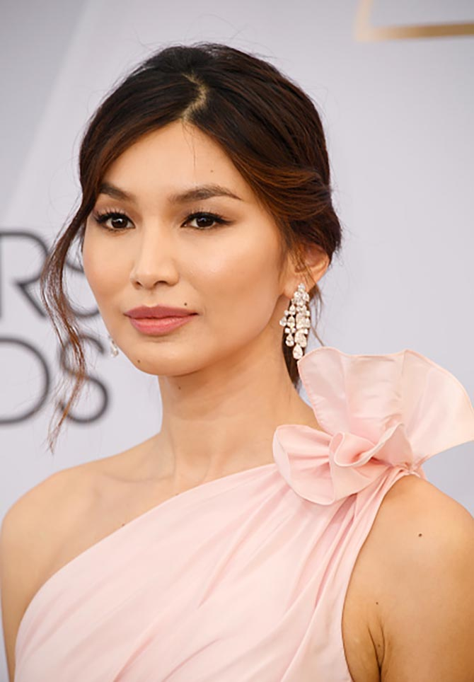 Gemma Chan wore Harry Winston vintage 1972 chandelier earrings set with 29.59-carats of diamonds in platinum.