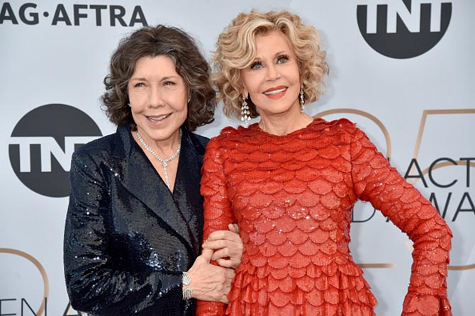 Lily Tomlin poses with Jane Fonda who is wearing Gismondi jewels