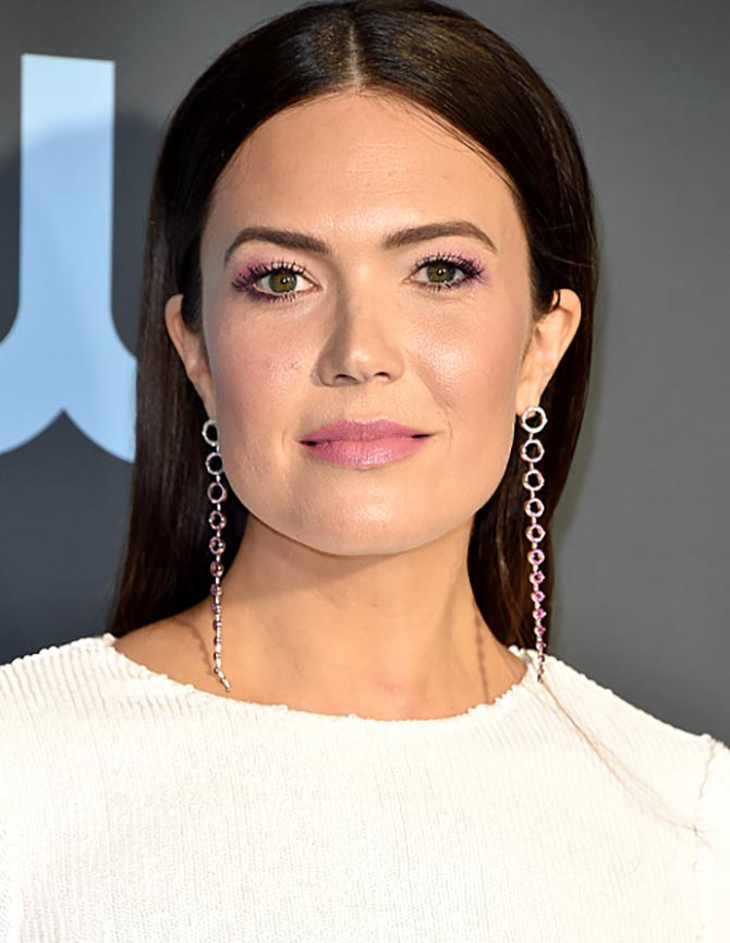 Mandy Moore wore Emmanuel Tarpin one-of-a-kind Oval Earrings set with diamond, rubies and sapphires at the Critics Choice Awards.