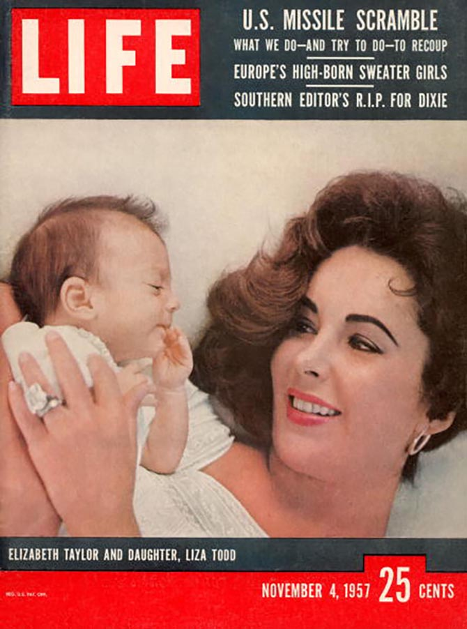 Elizabeth Taylor's engagement from Mike Todd got a national close up when she wore as she held her daughter Liza Todd for the November 4, 1957 cover shoot of Life magazine. Photo by Toni Frissell/The LIFE Premium Collection/Getty Images
