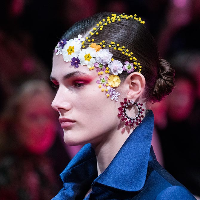 A model at the Alexis Mabille Spring '19 Couture show wearing Reza earrings.