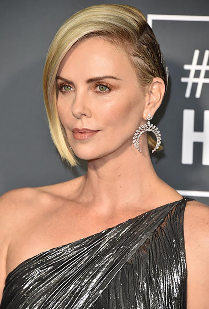 Charlize Theron in Messika diamond earrings at the Critics' Choice Awards