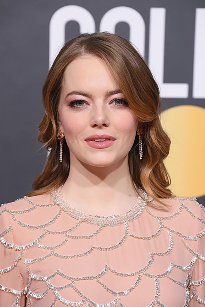 Emma Stone wore sparkling earrings that matched her gown.