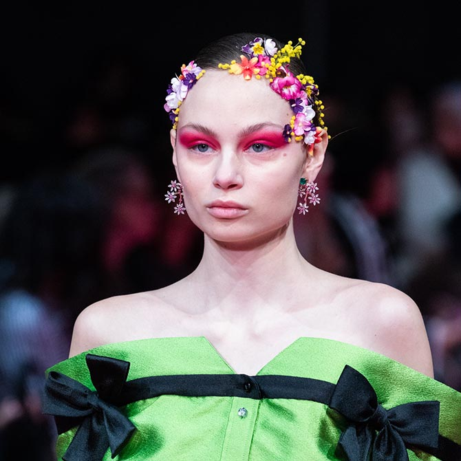 A model at the Alexis Mabille Spring '19 Couture show wearing Reza earrings