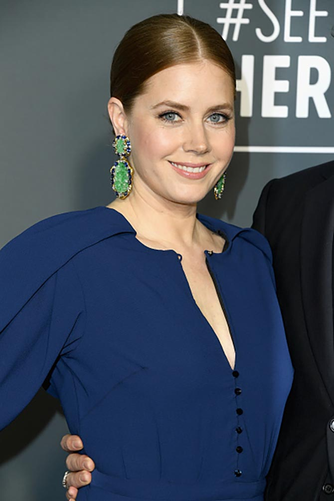 Amy Adams wears David Webb Earrings with jade, sapphires, diamonds, gold, and platinum at the Critics' Choice Awards.