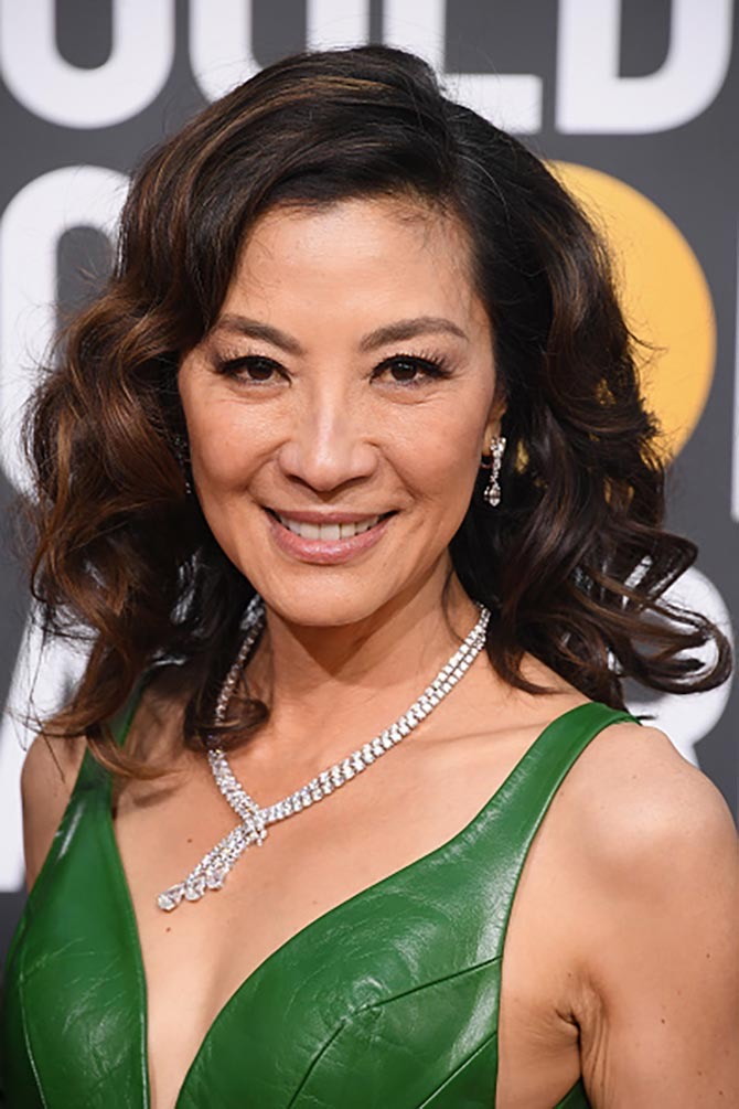Michelle Yeoh wore a diamond necklace as well as her own emerald and diamond ring that played a part in 'Crazy Rich Asians.'