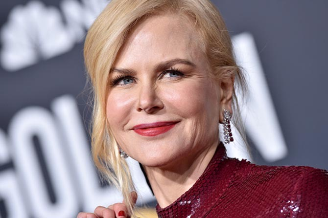 Nicole Kidman wore diamond and ruby earrings by Harry Winston.