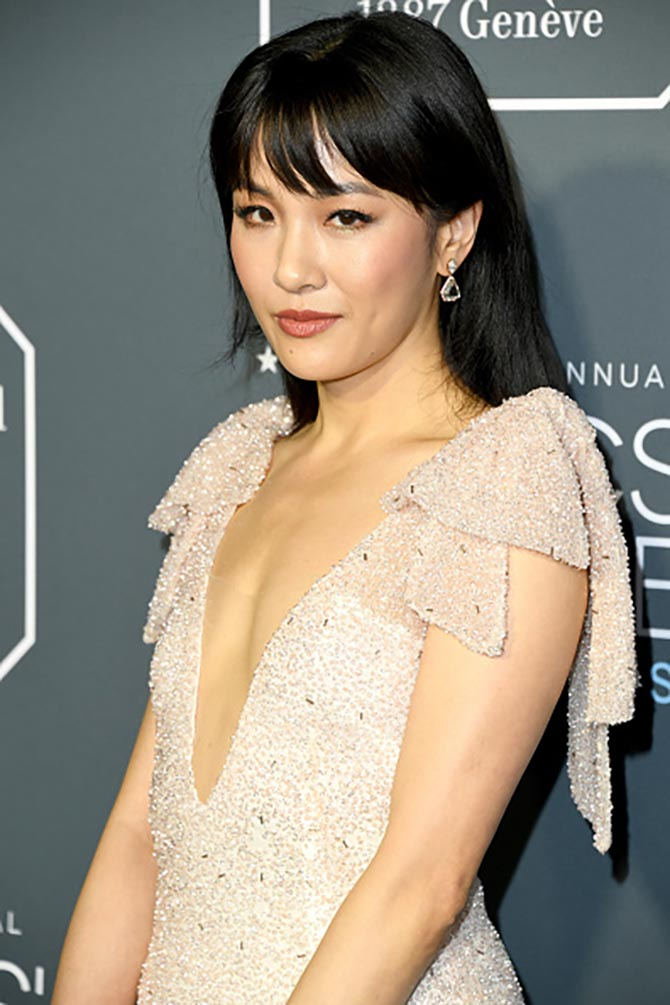 Constance Wu in Lorraine Schwartz earrings at the Critics Choice Awards