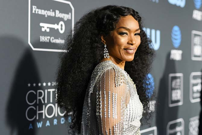 Angela Bassett in diamond chandelier earrings