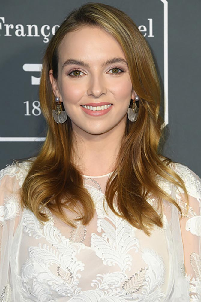Jodie Comer wore Silvia Furmanovich earrings Gingko earrings made from carved rock crystal, brown and white diamonds and pearls at the 24th annual Critics' Choice Awards at Barker Hangar on January 13, 2019 in Santa Monica, California.
