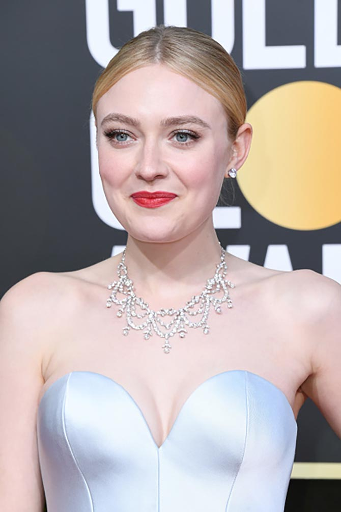 Dakota Fanning wore a Beladora vintage diamond necklace.