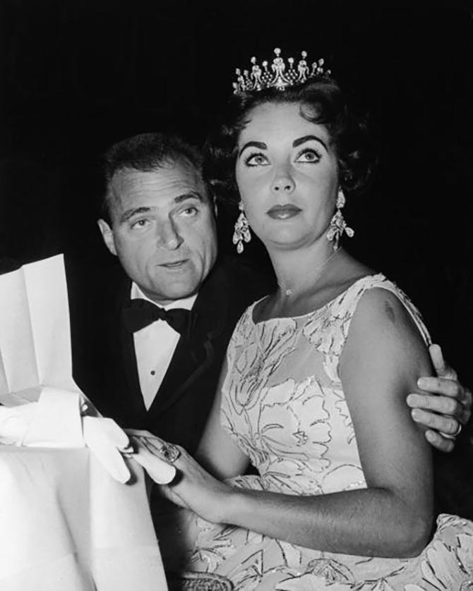 Mike Todd with Elizabeth Taylor wearing her tiara at a Golden Globe Awards ceremony at the Coconut Grove nightclub in Hollywood. The star also has on her chandelier earrings, heart shape diamond necklace and 29.5-carat engagement ring. Photo Getty
