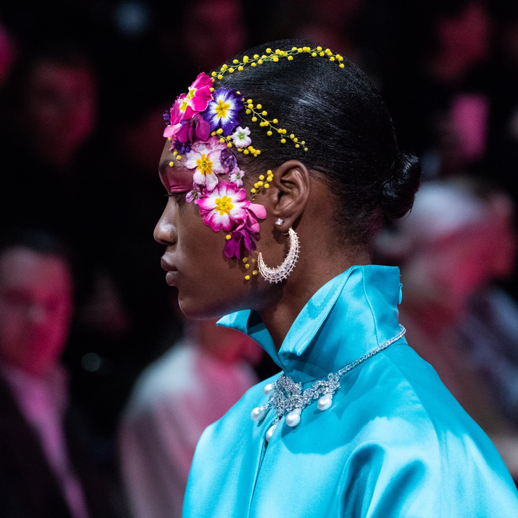 A model at the Alexis Mabille Spring '19 Couture show wearing Reza earrings and necklace