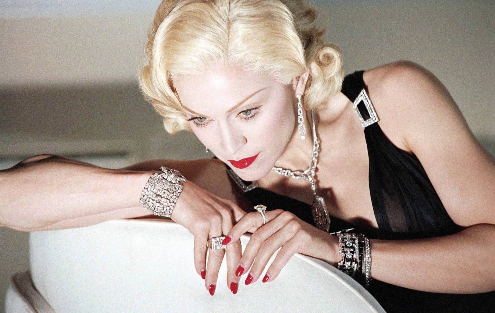 Madonna wearing Mae West's diamond bracelet among other jewels from Neil Lane's vintage collection in her 2006 video 'Hollywood.' Photo via