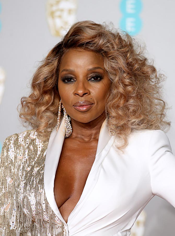 Mary J. Blige wearing mesh diamond earrings by Lorraine Schwartz.