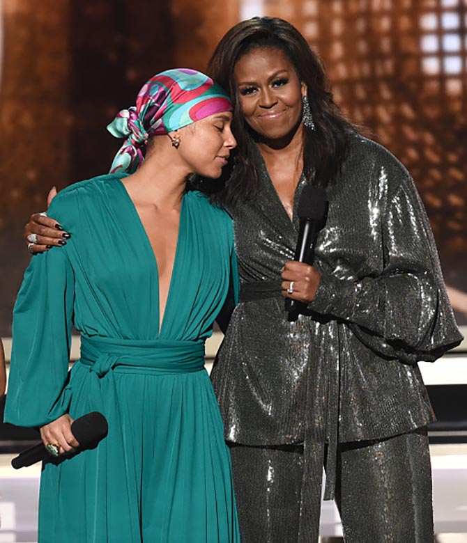 Alicia Keys in a Jill Heller vintage ring and Michelle Obama in diamond scarf earrings.