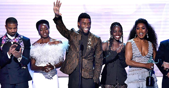 Chadwick Boseman wore Tiffany brooches when he formally accepted the Outstanding Performance by a Cast at the SAG Awards. He is flanked by Michael B. Jordan, Danai Gurira, Lupita Nyong'o and Angela Bassett. Photo Getty