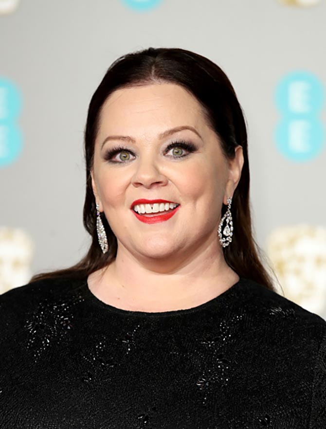 Melissa McCarthy wore vintage diamond earrings.