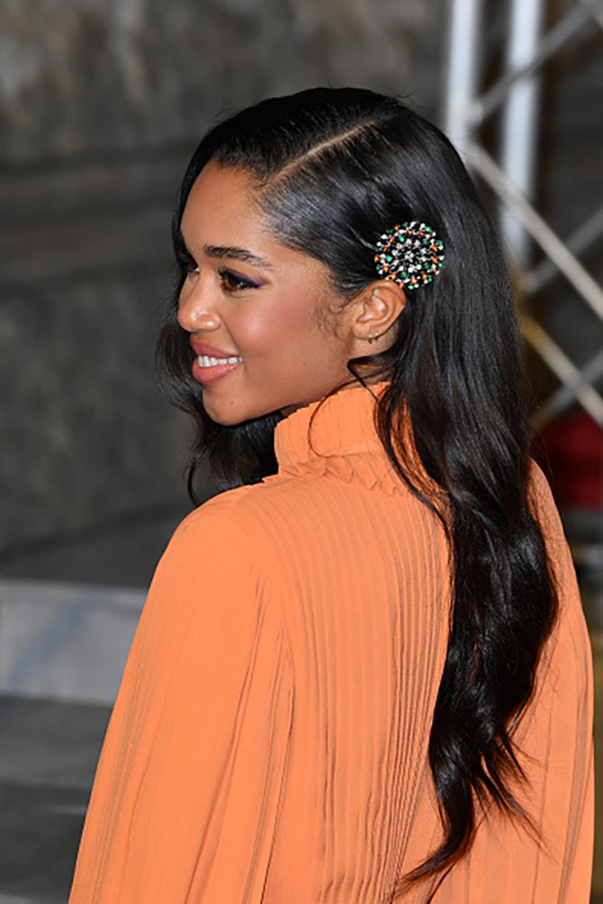 Laura Harrier wore a Bulgari clip in her hair.