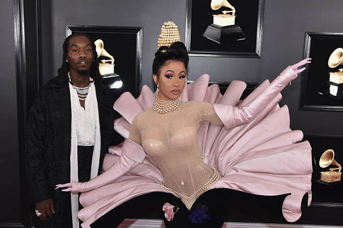 Offset of Migos and Cardi B in a vintage Thierry Mugler dress and 28-carat diamond earrings by Gismondi.