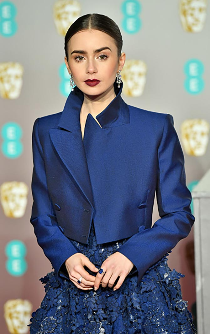 Lily Collins wore jewelry by Cartier to the BAFTAs
