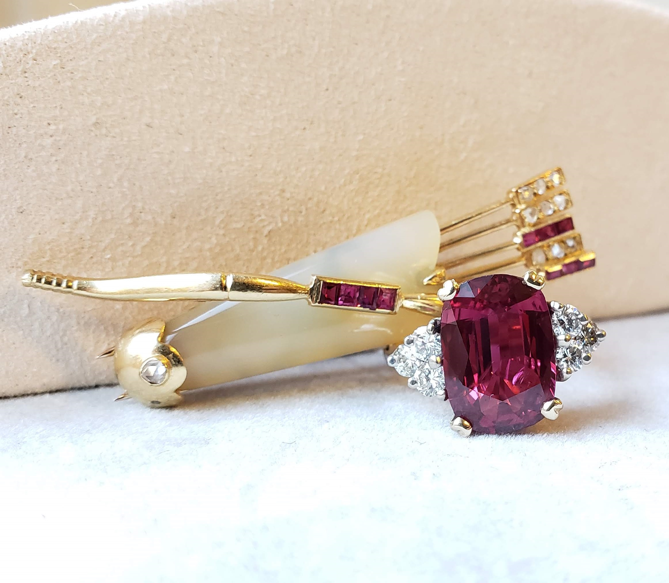 Cartier Quiver and Arrow brooch and ruby and diamond ring featured in Christie's online jewelry auction. Photo Christie's