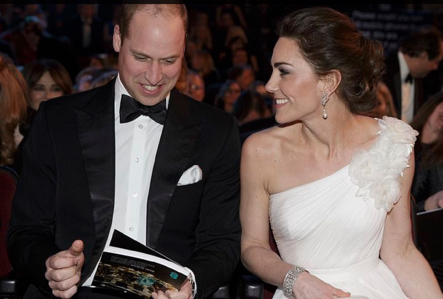 Prince William with Kate Middleton who is wearing Princess Diana's pearl and diamond earrings and a diamond bracelet from the Queen's collection with an Alexander McQueen dress. Photo via