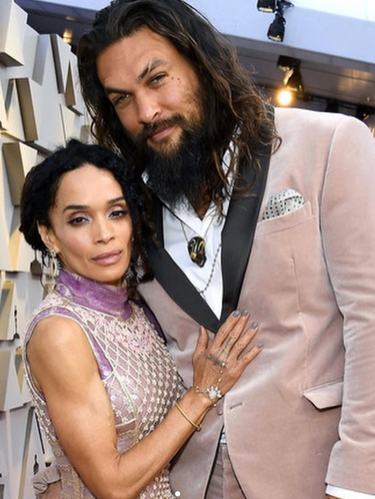 Jason Momoa and Lisa Bonet in layers of jewels include Fernando Jorge earrings and a Jacquie Aiche hand piece.