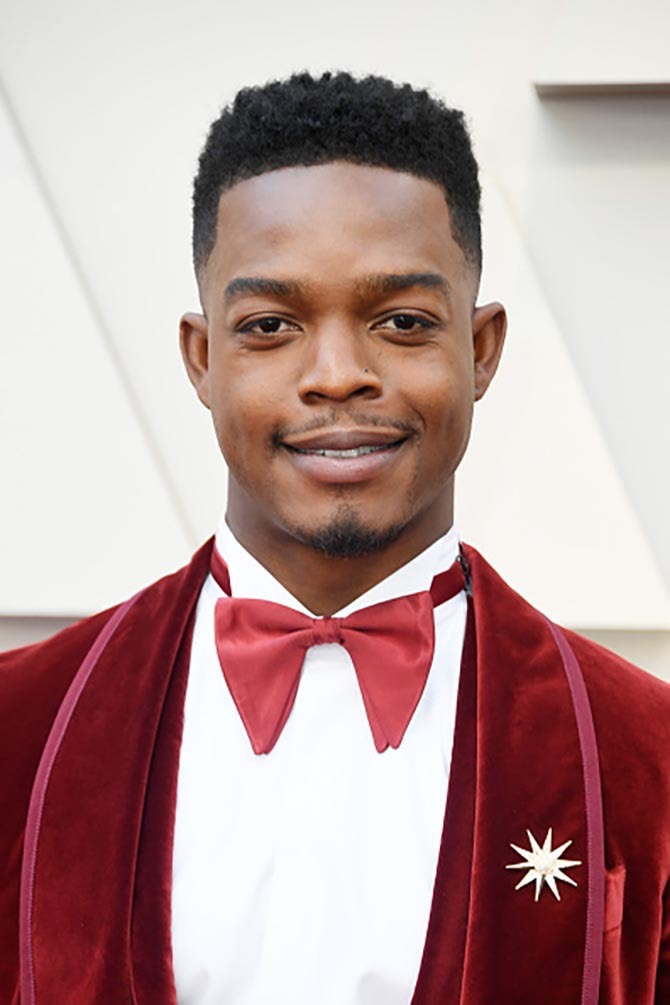 Stephan James wore a starburst brooch with his velvet tuxedo.