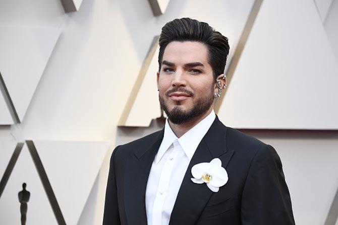 Adam Lambert in ear decor