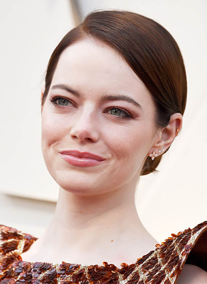 Emma Stone wore earrings by Louis Vuitton.