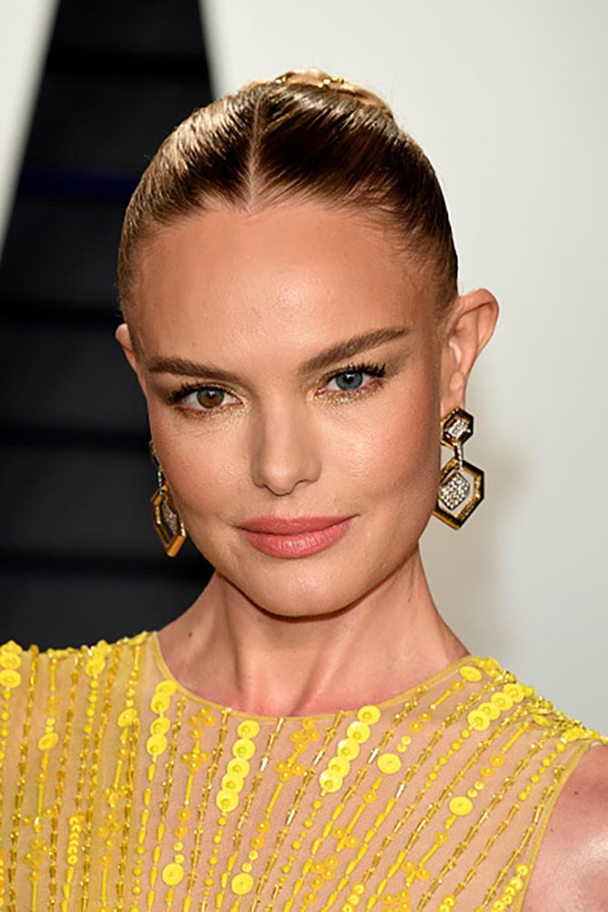 Kate Bosworth wore Davide Webb earrings.