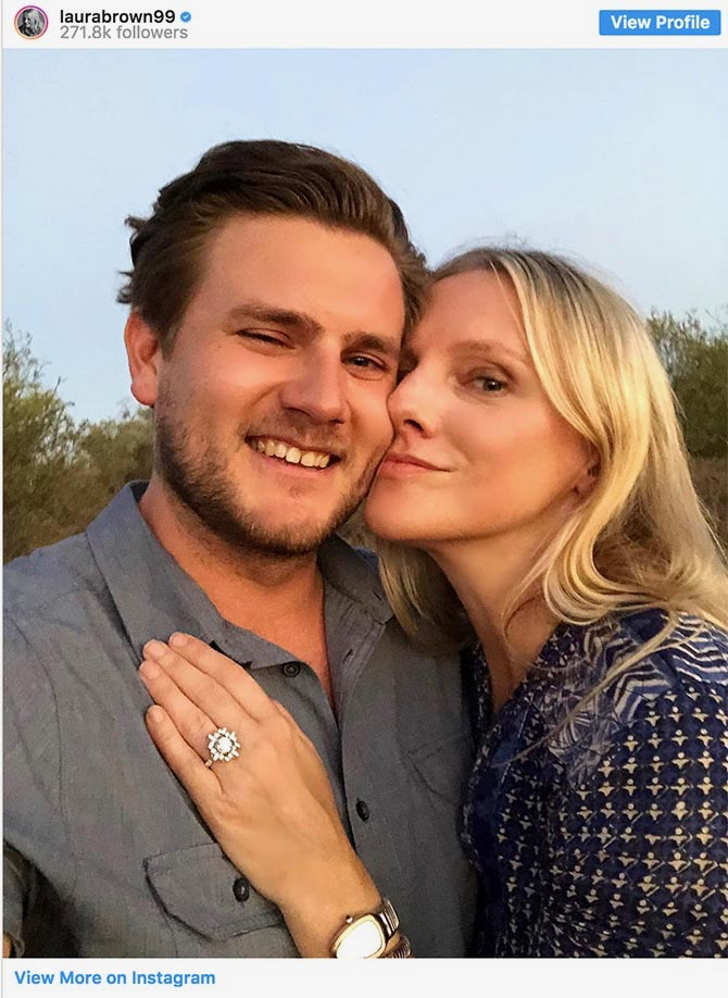 Laura Brown wearing her Canturi engagement ring and posing with her finace Brandon Geoffrey for an Insta post. Photo via @laurabrown99