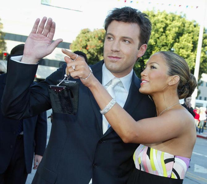 At the 2003 premiere of 'Daredevil,' Ben Affleck waves to the crowd with Jennifer Lopez who is wearing her pink diamond engagement ring. Photo Getty