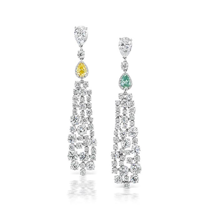Diamond earrings by Maria Canale set with a fancy intense yellow diamond and a rare blue green diamond. Photo courtesy