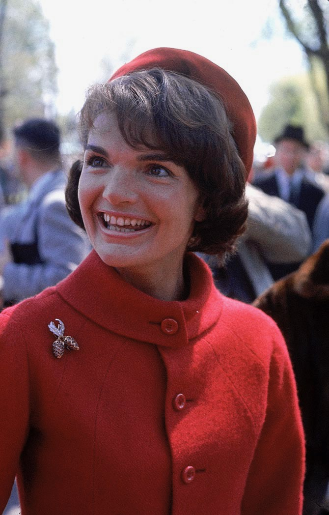 First Lady Jackie Kennedy wore her Tiffany ruby and diamond clip designed by Jean Schlumberger with an Oleg Cassini red wool suit and beret during a 1961 trip to Canada. Photo Getty