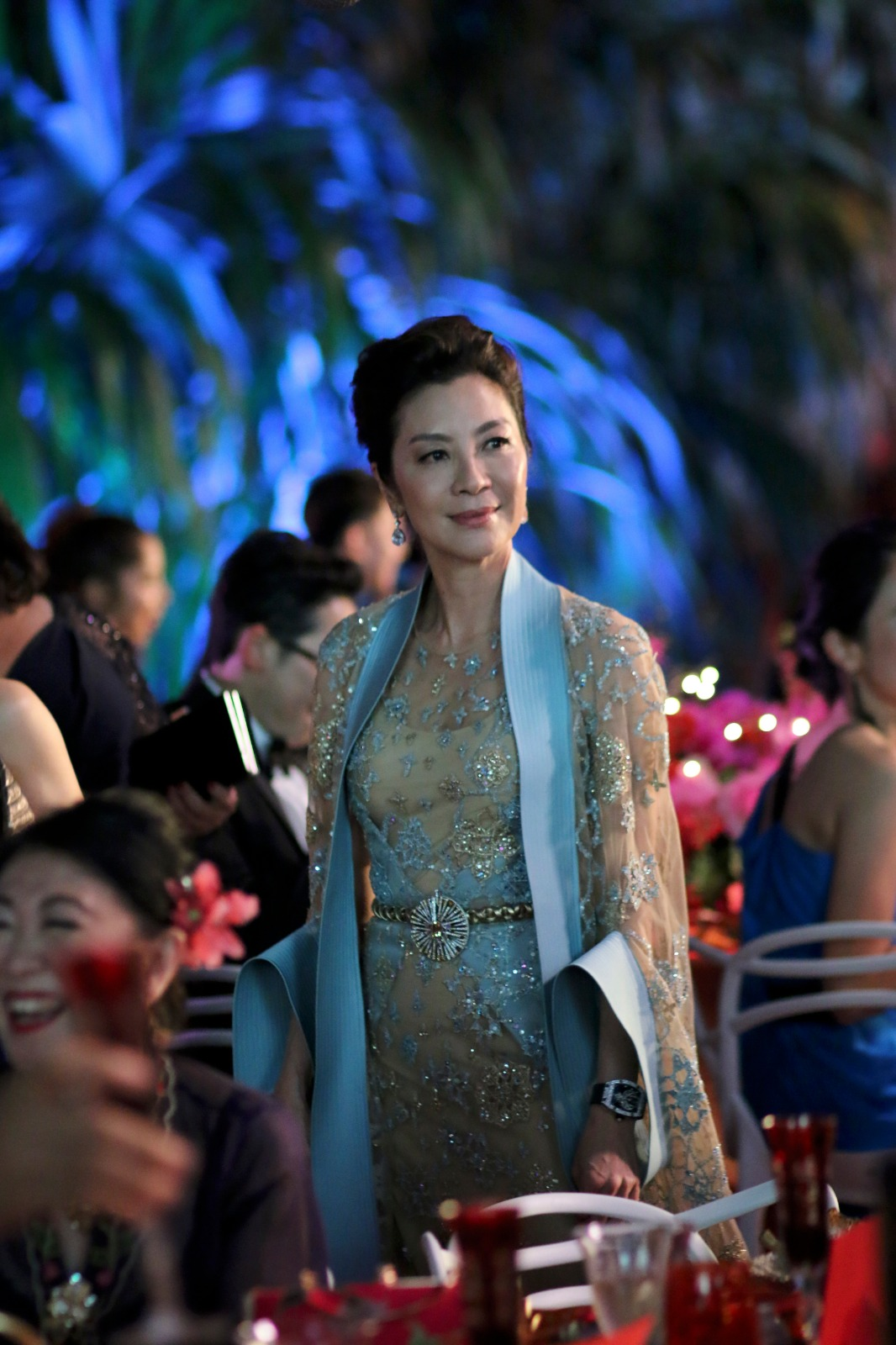 Michelle Yeoh wearing Sparkling Delight pendant from Carnet by Michelle Ong at her waist in 'Crazy Rich Asians.' Photo courtesy
