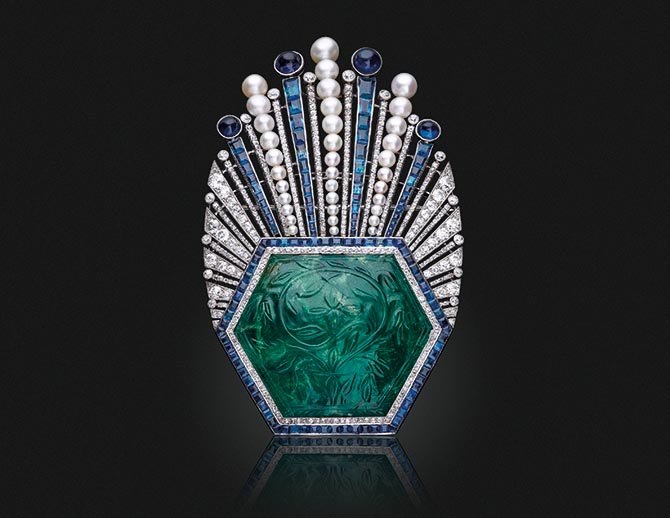 An Art Deco Carved Emerald, Sapphire, Diamond and Pearl Aigrette by Paul Iribe for Robert Linzelier being sold at Christie's in New York. Photo Christie's