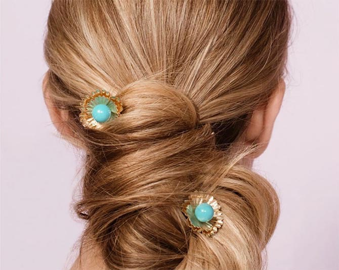 Turquoise and gold hairpins by Irene Neuwirth accenting an elegant updo. Photo courtesy