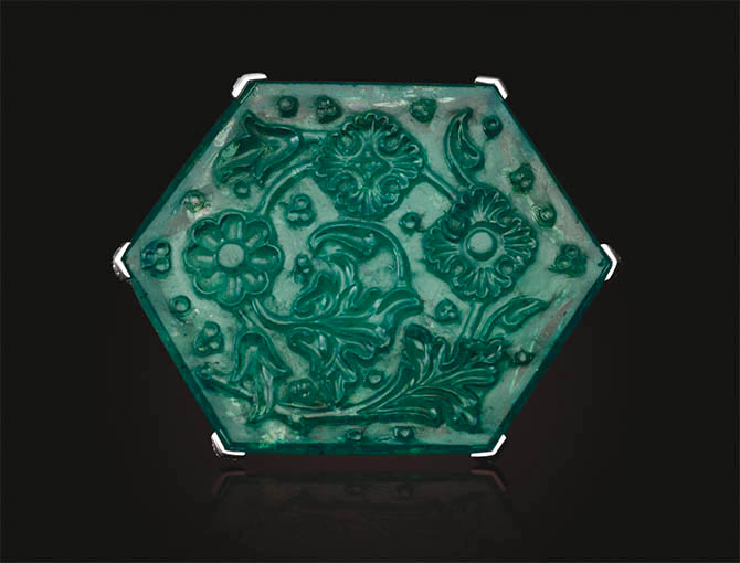 'The Taj Mahal Emerald' 141.13-carat Carved Emerald in a diamond brooch by Cartier. Photo Christie's