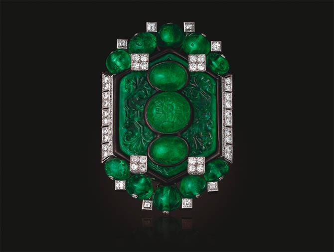 An Art Deco Emerald, Diamond and Enamel Brooch by Cartier being sold at Christie's in New York. Estimate $1,000,000 – $1,500,000 Photo Christie's