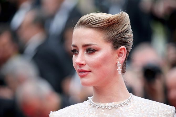 Amber Heard wore diamond jewelry by Chopard.