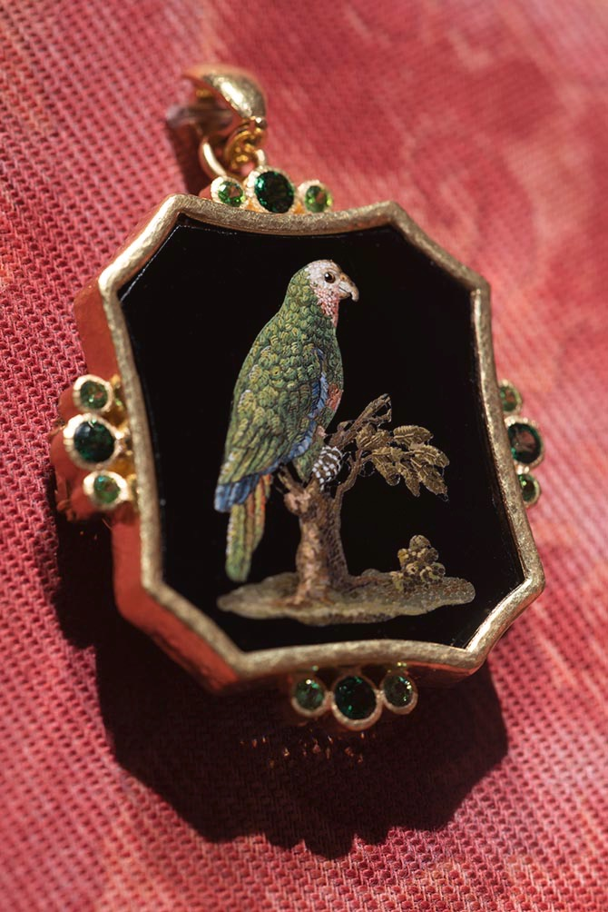 Gallery view of 'A Return to the Grand Tour' showing a 19th century micromosaic of a parrot set in an Elizabeth Locke pendant accented with tsavorites and demantoid garnets. Photo: David Stover © Virginia Museum of Fine Arts.