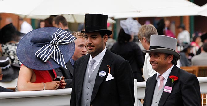 Sheikh Hamad bin Abdullah Al Thani at Ascot in 2013 with Andreas Woehler. Photo Alamy