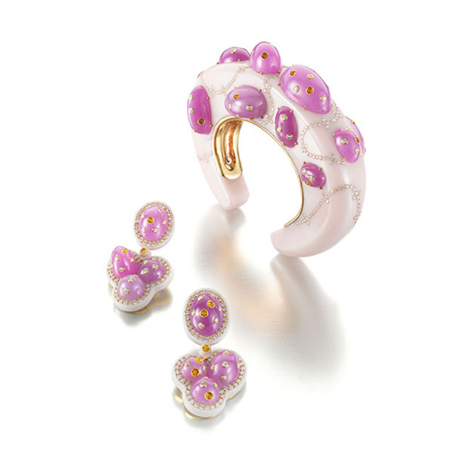 Daniel Brush's pink Bakelite Jellybean bracelet and earrings set with rubies and diamonds. Photo courtesy of Siegelson