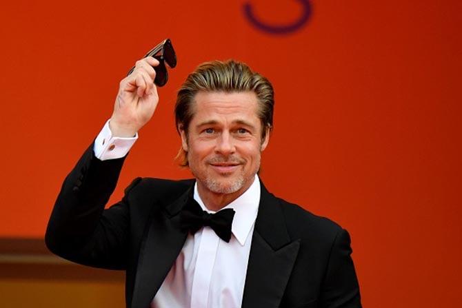 Brad Pitt wearing cuff links.